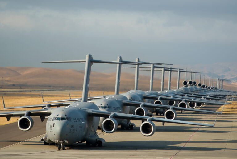 """A 22-aircraft """"freedom launch"""" took place at Travis AFB, Calif., Sept. 11, 2013. Seven C-17 Globemaster IIIs, 11 KC-10 Extenders and four C-5B Galaxies from the 60th Air Mobility Wing lined up and then launched consecutively over 36 minutes to take part in Air Mobility Command missions. The first plane in the lineup, a C-17, launched at 8:46 a.m., the same time terrorists crashed American Airlines Flight 11 into the North Tower of the World Trade Center in New York City 12 years earlier. (U.S. Air Force photo/Ken Wright)"""